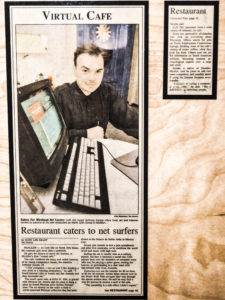 Anthony Acosta's Cafe Ole Cyber Cafe featured in a Newspaper Article